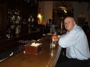 Enjoying a Singapore Sling at the Raffles Bar